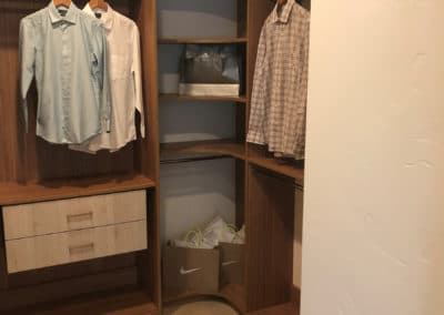 A luxury walk-in closet that is elegant and functional when filled