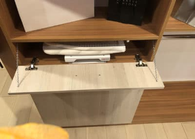 For extra convenience, the closet features a pull-out foldable ironing board