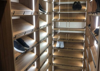 Plexo glass shoe fences secure the shoes from falling off the luxury shoe rack