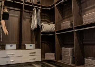 Take a closer look at this modern closet's pull down system from a Las Vegas model home.