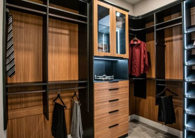 Another look at the Men's Side of this luxury master bedroom closet.