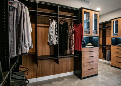 A two-toned, stunning his and hers closet with many features in Sandalwood community in Summerlin.