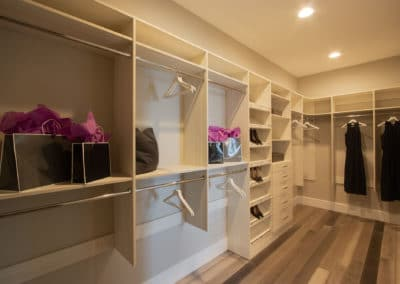 Check out the details on this white wood closet shevling, in this his and hers custom closet in Las Vegas!