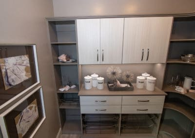 See how we tie in functionality and beauty in this luxury, custom pantry shelving system complete with a tabletop, removable baskets, and more!