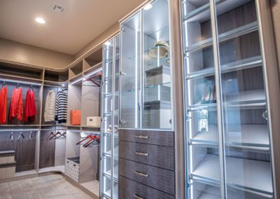 aluminium framed shoe racks and cabinets glass doors in an expensive walk in closets