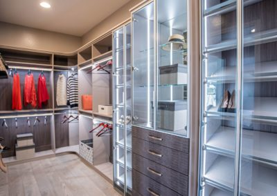 Stunning luxury closet design with sophisticated features by Closets Las Vegas