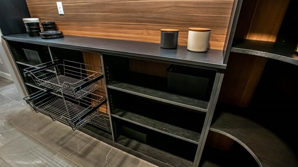 Take a better look at this custom kitchen pantry design with three layer dark brown shelves and detachable steel baskets