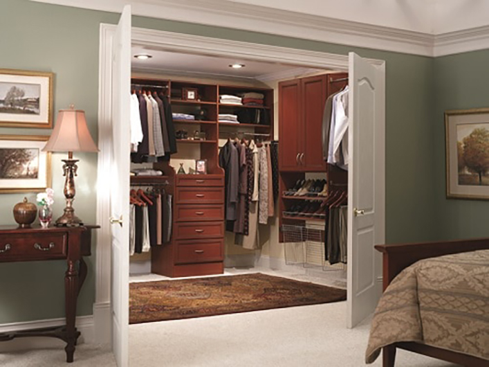 Catch sight of this elegant high end walk in closet in a master bedroom