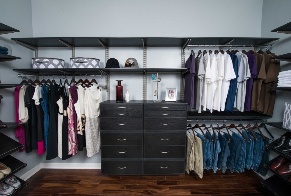 Have a closer look at this elegant master walk-in closet organizer in Midnigth Live featuring freedomRail.