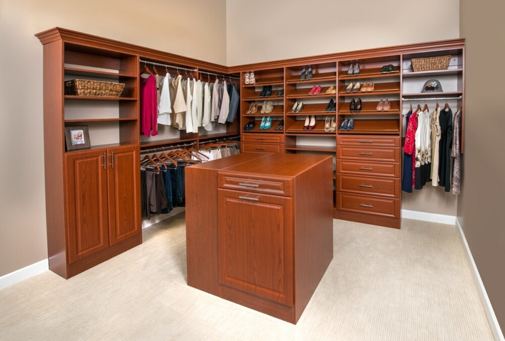Look how elegant this luxury custom walk-in closet is in Modern Cherry
