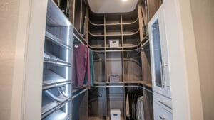 Entrance to the His side of a luxurios closet in a master bedroom with his and hers closets in Las Vegas