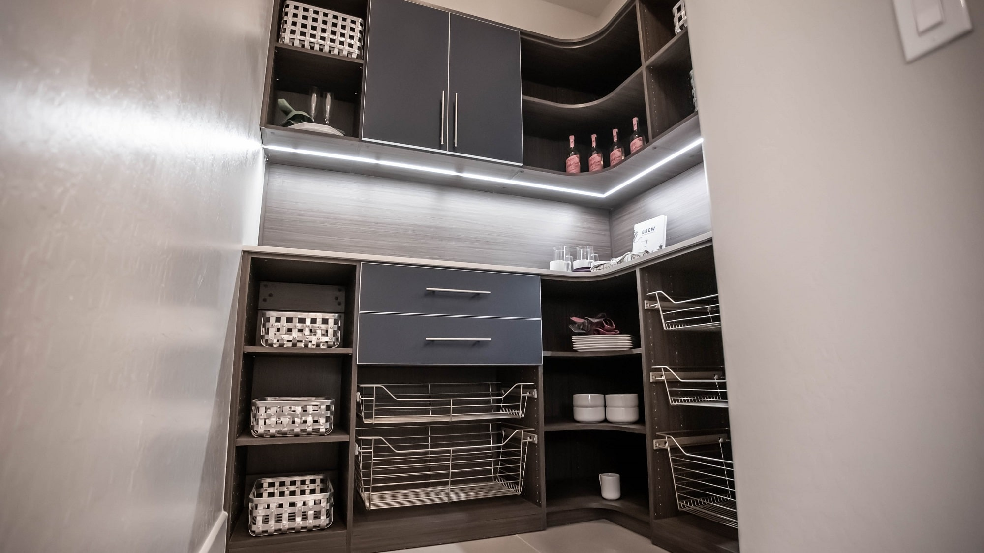 walk in pantry with painted glass drawers and pull out baskets for ravenwood las vegas home