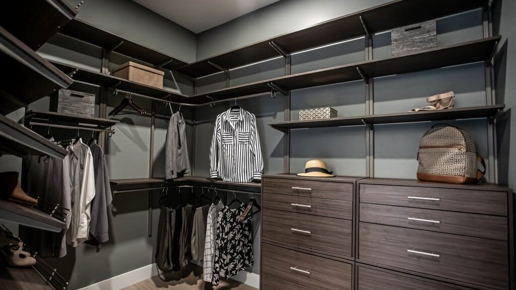 freedomRail is used for this his and hers walk in closet design.