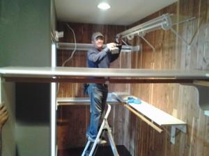 Ramon at work removing dysfunctional closet.